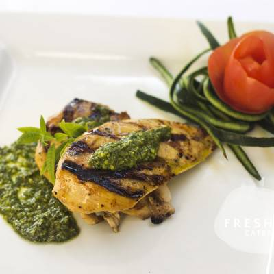Grilled chicken topped with a pecan pesto sauce