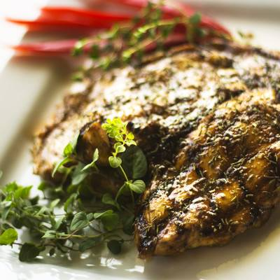 Grilled chicken with Caribbean spices. Served with a side of steamed carrots