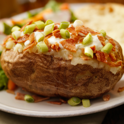 Baked potato loaded with bacon, celery, and cheese