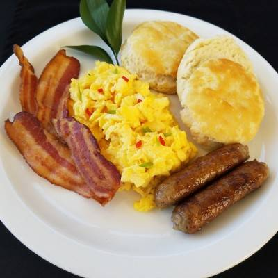 classic breakfast with Bacon, eggs, biscuit, and sausage