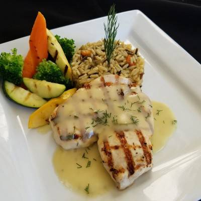 Grilled chicken with a lemon tarragon sherry sauce. Served with mixed veggies and rice
