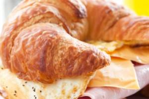 Croissant sandwich with egg and melted swiss