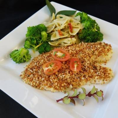 Crusted tilapia with tomatoes and parmesan on top. Served with bowtie pasta and broccoli