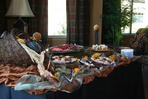 A fall themed display of an assortment of deserts