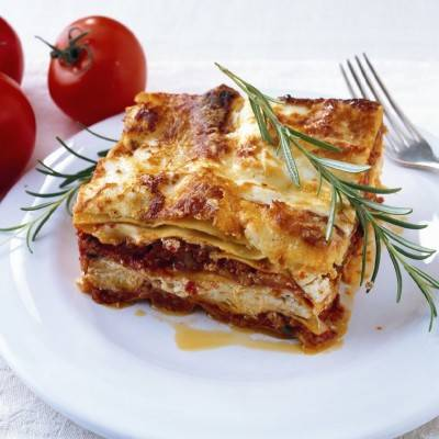 Traditional Baked Lasagna with layers of meat and cheese.