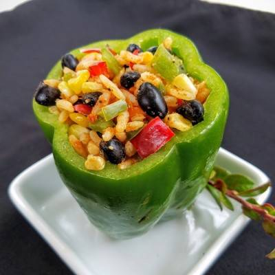 Pepper stuffed with rice, black beans, and chopped bell peppers- vegetarian