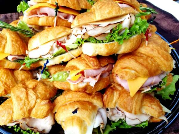 Variety of mini croissant sandwiches on a platter