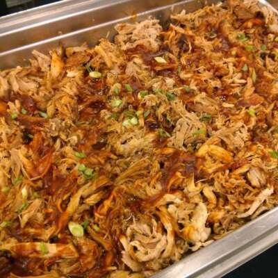Pulled pork smoked and topped with BBQ sauce and chives