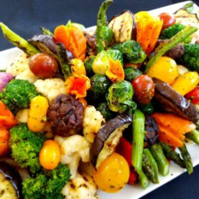 grilled veggie platter with zucchini, squash, cherry tomatoes, mushrooms, bell peppers, olives and asparagus