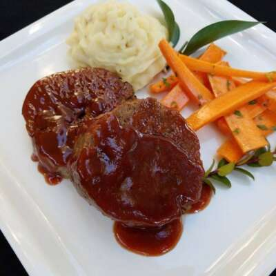 Meatloaf with side of carrots and mashed potatoes