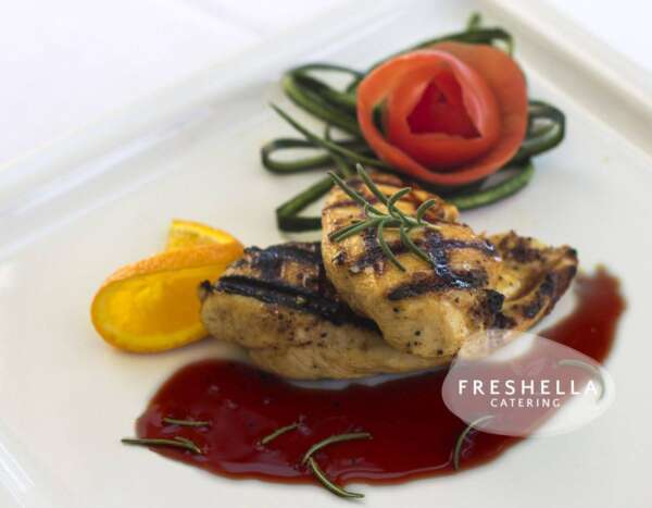 Grilled chicken breast with pomegranate glaze