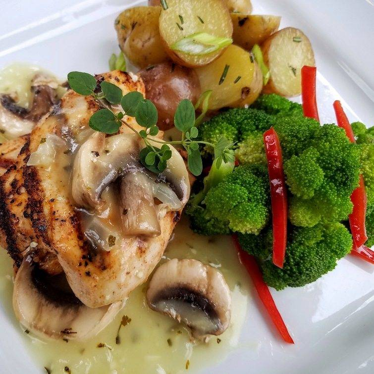 Grilled chicken with mushroom and thyme sauce