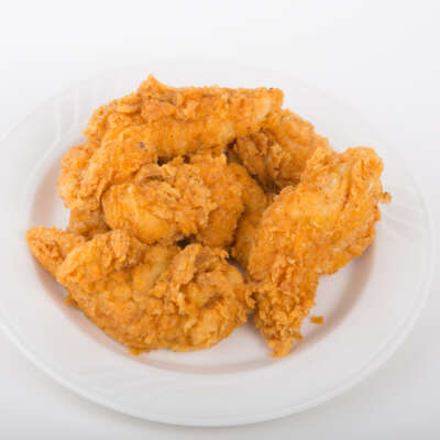 fried chicken breast on white plate