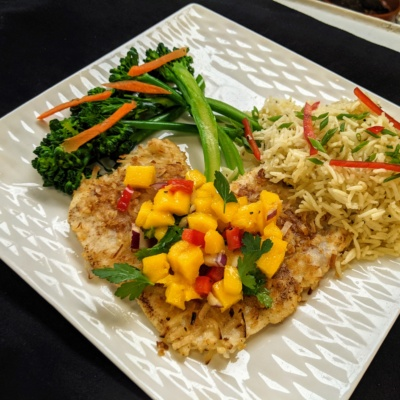 Coconut encrusted chicken with mango salsa. Basmati rice and steamed broccolini.