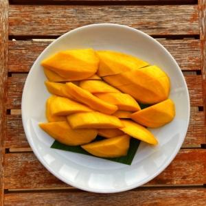 Plate of freshly cut mangoes
