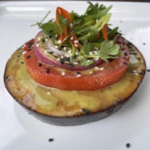 Eggplant with tomato, cilantro and seasame seeds